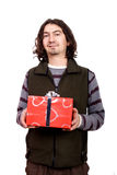 Couple giving a present. Young man giving a present to a pretty woman Royalty Free Stock Photo