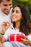 Couple giving present on birthday or anniversary celebration Royalty Free Stock Image