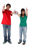 Couple giving the thumbs-up Royalty Free Stock Photography