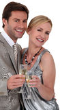 Couple with a glass Stock Photography