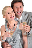 Couple with a glass of champagne Royalty Free Stock Image