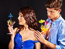 Couple with glass of cocktail. Beauty couple with glass of cocktail royalty free stock photos