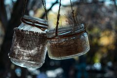Two glass jars on the rope stock photos
