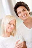 Couple with a glass of milk Stock Image