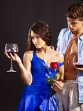 Couple with glass os wine and flower. Stock Images