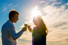 Couple with a glass of red wine Stock Photos