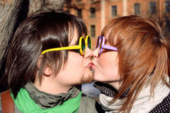 Couple with glasses. Kiss a guy and girl with glasses Royalty Free Stock Images