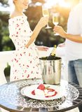 Couple with glasses of champagne. Happy couple with glasses of champagne outdoor celebration party stock photography
