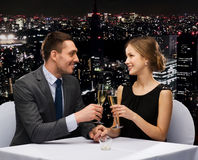 Couple with glasses of champagne at restaurant Stock Images