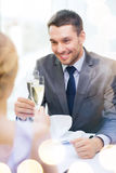 Couple with glasses of champagne at restaurant Royalty Free Stock Image