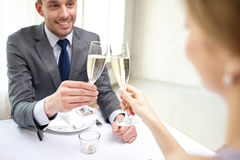 Couple with glasses of champagne at restaurant Royalty Free Stock Photography