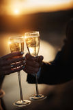 A couple of glasses of champagne at sunset Stock Images