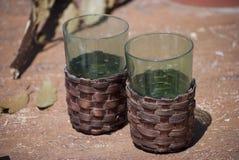 Couple glasses in wicker box Stock Photos