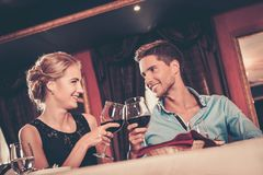 Couple with glasses of wine in restaurant Royalty Free Stock Photo