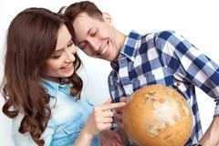 A couple with globe Royalty Free Stock Photo