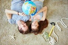 Couple with globe Stock Image