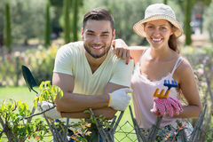 Couple in gloves with horticultural sundry Stock Photography
