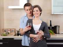 Couple with goblets hugs one another Stock Photos