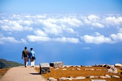 Couple going on road to blue sky in Madeira Island Royalty Free Stock Image