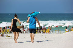 Couple going to the beach stock photos