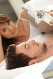 Couple going to bed Stock Photography