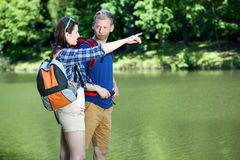 Couple going on a trip. Young couple going on a summer trip Royalty Free Stock Image