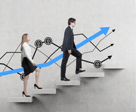 A couple is going up. A concept of the successful business team is making efforts at the career stairs Royalty Free Stock Photo