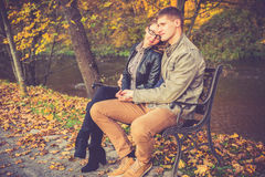 Couple in gold fall Royalty Free Stock Photography