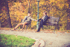 Couple in gold fall Stock Photography