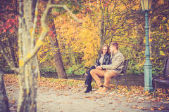 Couple in gold fall Royalty Free Stock Image