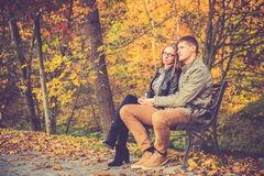 Couple in gold fall Stock Photo