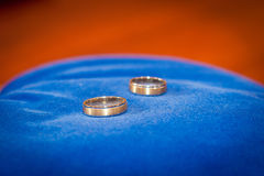 Couple of gold wedding rings on blue Royalty Free Stock Image