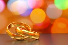 Couple of gold wedding rings on bokeh background,3d rendering. Stock Photography