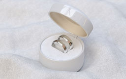 Couple of gold wedding rings  in jewelry white box Stock Photo