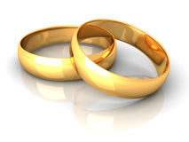 Couple of gold wedding rings on white background Royalty Free Stock Images