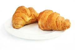 Couple of golden brown croissant Stock Image
