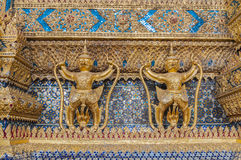 Couple of golden garuda statue in front of buddhist church, Wat Royalty Free Stock Images