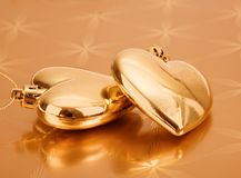 Couple of golden hearts Royalty Free Stock Images