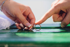 Couple with Golden Rings. Couple holding their wedding rings Stock Image