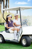 Couple in golf buggy Royalty Free Stock Photos