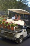 Couple In Golf Cart At Botanical Garden Stock Image