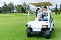 Couple in a golf cart Royalty Free Stock Photos