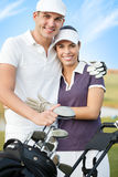 Couple on golf course Stock Photo