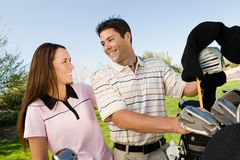 Couple On Golf Course Smiling Royalty Free Stock Photo