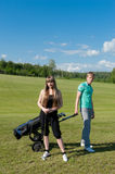 Couple on golf field Stock Photography