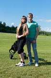 Couple on golf field Royalty Free Stock Images