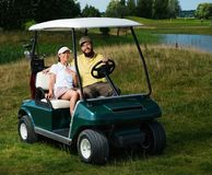Couple on a golf field Royalty Free Stock Image