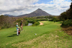 Couple on golf green Royalty Free Stock Photos