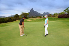 Couple on golf green Royalty Free Stock Photography
