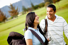 Couple of golf players Royalty Free Stock Photo